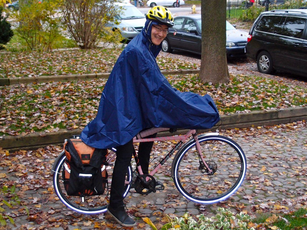 in praise of rain capes biking in a big city